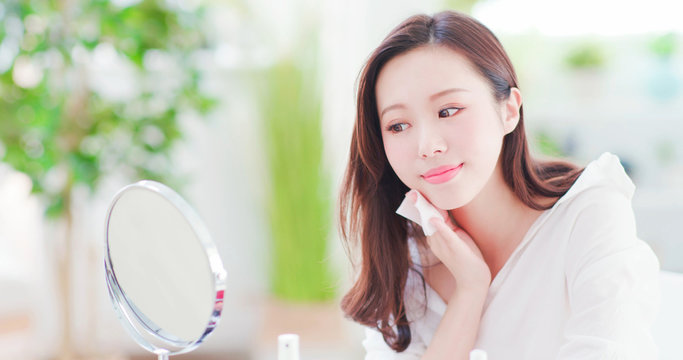 asian woman use cleansing cotton