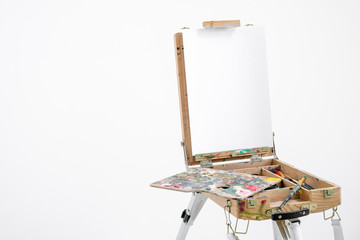Artist easel with blank canvas on a white background.