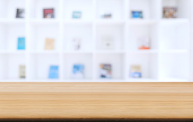 Selected focus empty old wooden table and .Library or Bookstore blur background with bokeh image....