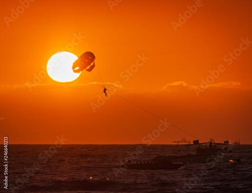 Amazing Shot At Sunset Of Parasailing Water Amusement