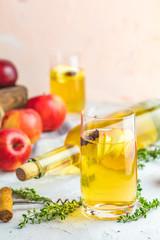 Bottle and glasses of homemade organic apple cider