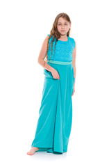 Girl 10-11 years old in a long emerald dress with bare feet. Isolation on a white background