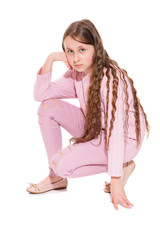 A girl of 10-11 years old with long beautiful hair sat on one knee. Isolation on a white background.