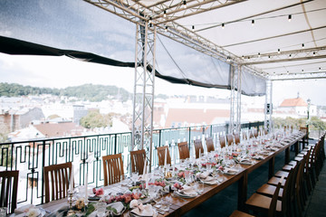 Set tables for wedding dinner  on the roof of the house