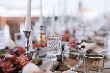 Elegant Wedding table set with pink wlowers and candlesticks
