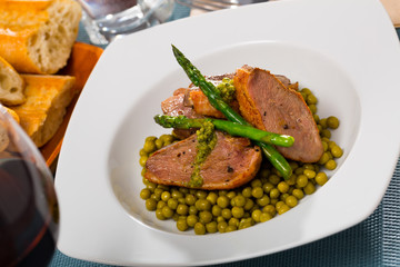 Duck breast with green pea and asparagus