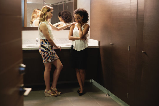 Sad Girl Crying For Problems In Office Toilets With Friend