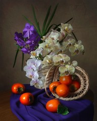 Still life with bouquet of orchids and persimmon