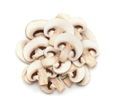Slices of fresh champignon mushrooms on white background, top view