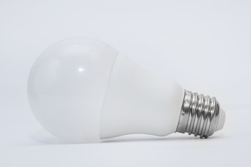 Light bulb on a gray background. Side view