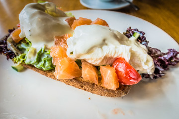 Eggs poached with salmon on bread