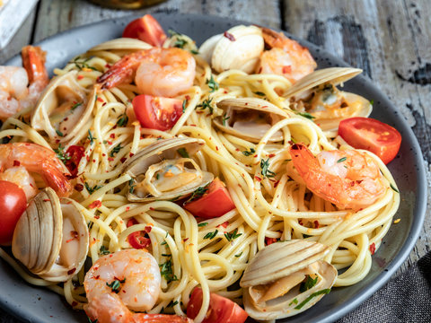 Cooked pasta with seafood clams, shrimps tomato on a plate , spaghetti