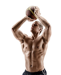 Basketball player shooting at the hoops. Photo of shirtless muscular man isolated on white background. Strength and motivation.