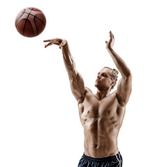 Muscular basketball player shooting at the hoops. Photo of shirtless handsome man isolated on white background. Strength and motivation