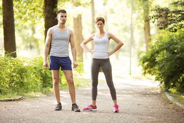 Spoed Fotobehang Jogging Young happy couple doing exercises together outdoors