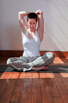 Woman Stretching on an Exercise Mat