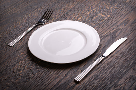 white plate on wooden