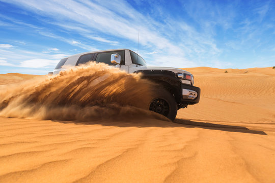 Drifting offroad car 4x4 in desert