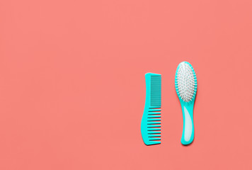 Two turquoise hair combs on living coral colored desk.. Trend flat lay living coral toned image for bloggers, designers, magazines etc.