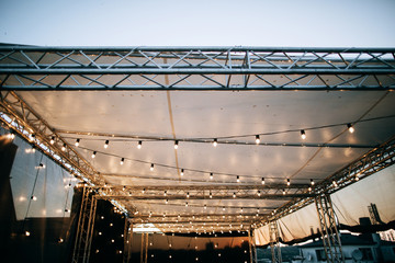 Lighting at the wedding restaurant. Decorated with garlands with lamps