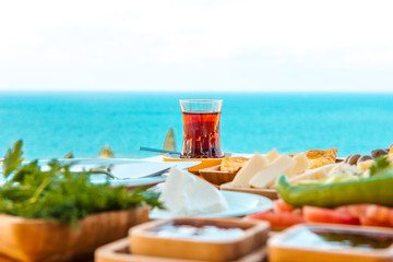 Breakfast on the beach at hotel or resort by the sea in summer season. Holiday and vacation breakfast image.