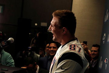 New England Patriots tight end Rob Gronkowski laughs while speaking to reporters ahead of Super Bowl LIII in Atlanta