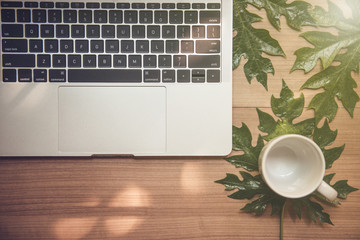 Laptop on a wooden table and a cup of coffee - Images.