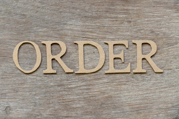 Alphabet letter in word order on wood background