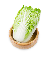 Fresh chinese cabbage in wooden bowl.