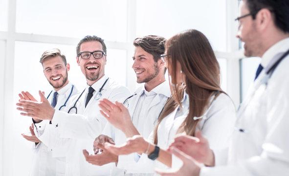 group of successful doctors applauds