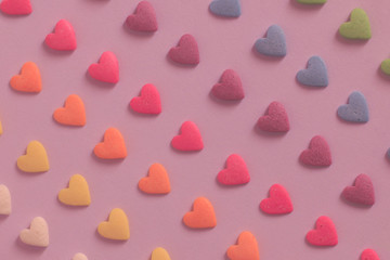 Colorful heart shaped candy pattern background