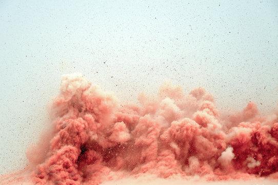 Flying rocks and dust clouds after detonator blast in the desert