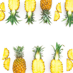 Food frame with juicy pineapple fruits on white background. Flat lay, top view. Food concept.