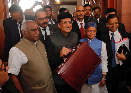 India's interim Finance Minister Piyush Goyal holds his briefcase as he arrives at the parliament to present 2019-20 budget in New Delhi
