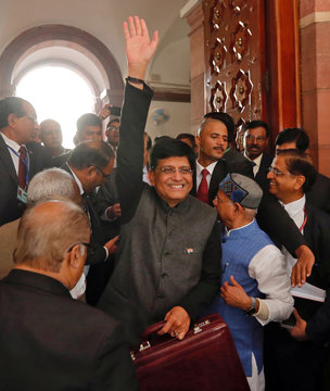 India's interim Finance Minister Piyush Goyal waves as he holds his briefcase upon arrives at the parliament to present 2019-20 budget in New Delhi