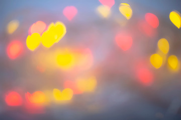 Bokeh heart shapes abstract background.