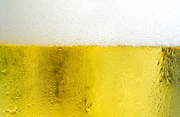Cool beers with beer bubbles on top a glass at the party or congratulations party or holiday , weekend time , relax time. A man pouring fresh beer. Party Time at Pub and Restaurant Concept.