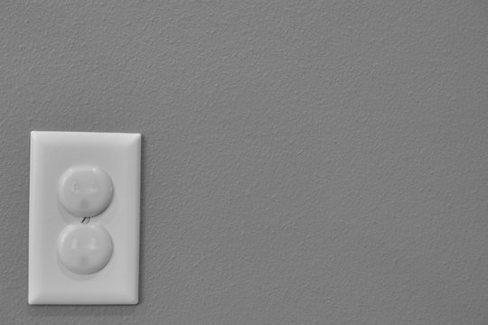 Child proofed covered electrical outlet