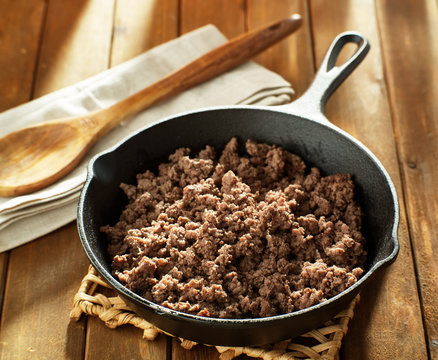 browned ground beef in cast iron skillet