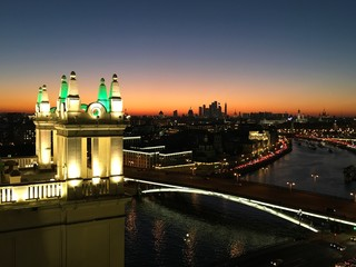 Day to Night of Moscow Kremlin and Moscow River in Autumn Sunny Evening. Russia. View from Kotelnicheskaya stalinist high rise building. Rooftop, Kremlin towers and churches