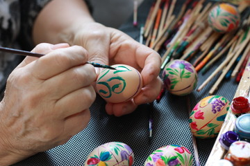 handmade painted easter eggs hands of a woman