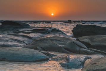 Bold Orange Rocky Coastal Sunrise