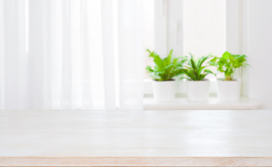 Empty top of wooden table on blurred curtained window background Wall mural