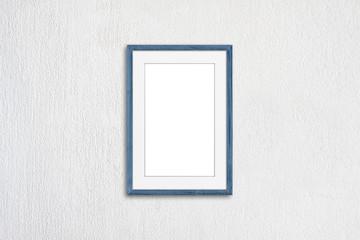 Blank photo frame mock up, light grey blue realistic  wooden framework on white plastered wall
