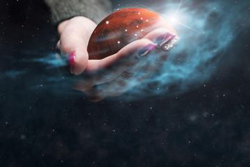 Woman holding New Home Mars. Nebula dust. Mixed media.
