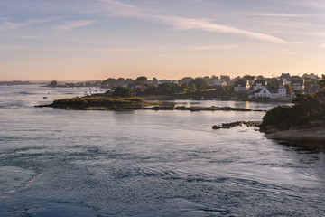 French landscape - Bretagne. A small fishing village in a beautiful bay after sunrise.