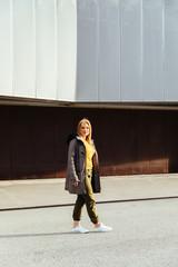 Blonde girl walking in the cityv