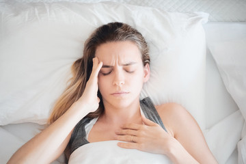 Woman at home, stress or pain