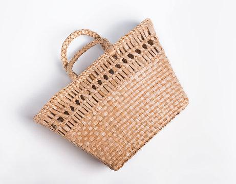 Straw bag basket isolated on the white backgroun