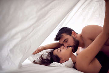 couple lovers having sex on a bed in morning with lust and love. Sex couple. Having sex..